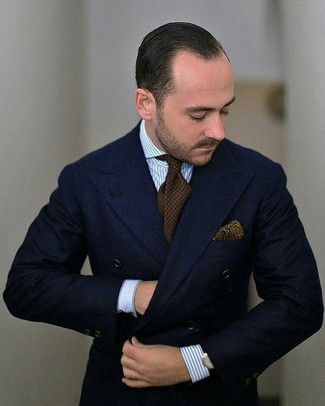 How to wear: olive paisley pocket square, dark brown knit tie, light blue vertical striped dress shirt, navy wool double breasted blazer