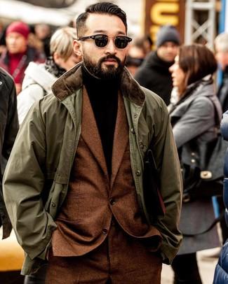 How to wear: black sunglasses, dark brown turtleneck, tobacco wool suit, olive barn jacket