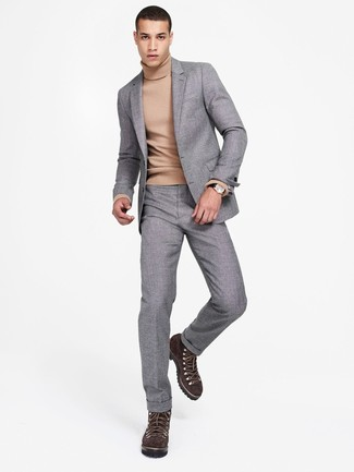 How to Wear a Tan Turtleneck For Men: A tan turtleneck looks so sophisticated when paired with a grey wool suit. To infuse a more relaxed vibe into your outfit, add dark brown suede work boots to the equation.