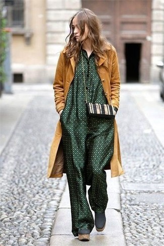 How to wear: black and white leather crossbody bag, dark green chunky suede ankle boots, dark green polka dot jumpsuit, mustard coat