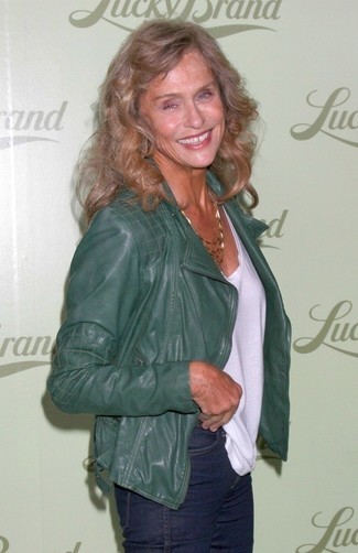 Lauren Hutton wearing Dark Green Leather Biker Jacket, White Crew-neck T-shirt, Navy Jeans, Gold Necklace