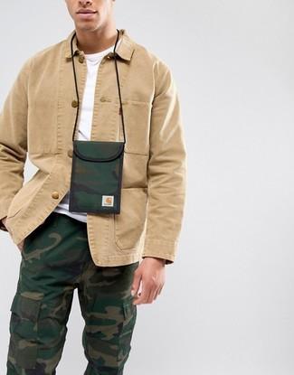 How to wear: dark green camouflage canvas neck pouch, dark green camouflage cargo pants, white crew-neck t-shirt, tan shirt jacket
