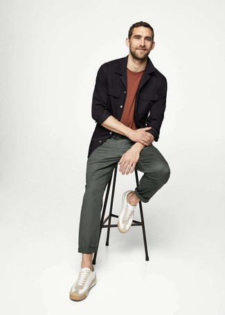 How to wear: white leather low top sneakers, dark green chinos, brown crew-neck t-shirt, black shirt jacket