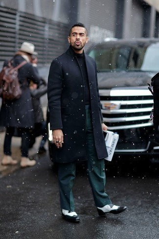 Men's Looks & Outfits: What To Wear In Fall: A navy overcoat and dark green dress pants are essential in any modern gentleman's closet. Wondering how to finish? Complement this look with a pair of black and white leather brogues for a more laid-back vibe. This combo is a wonderful option when it comes to a kick-ass look that transitions easily into fall.