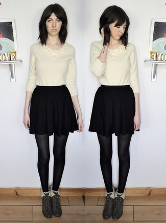 How to wear: dark green suede ankle boots, black skater skirt, beige fluffy crew-neck sweater