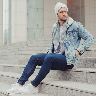 How to wear: light blue denim jacket, grey crew-neck t-shirt, navy jeans, white athletic shoes