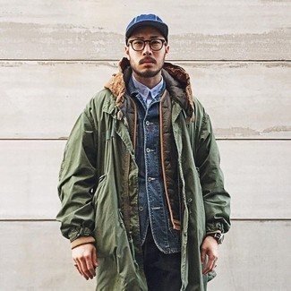 How to wear: light blue long sleeve shirt, navy denim jacket, olive quilted gilet, olive parka
