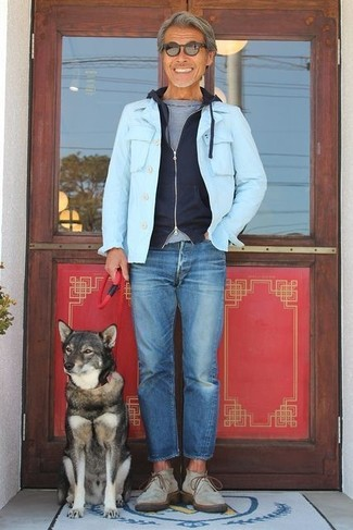 How to wear: light blue denim jacket, black hoodie, grey crew-neck t-shirt, blue jeans