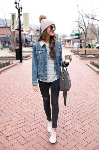 How to wear: blue denim jacket, white and navy horizontal striped long sleeve t-shirt, black ripped skinny jeans, white low top sneakers