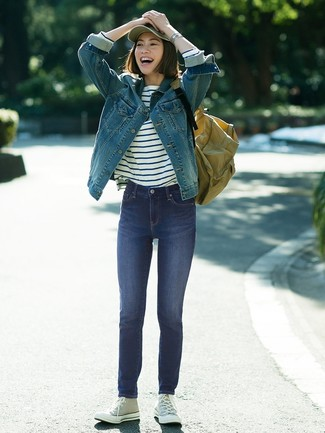 How to wear: blue denim jacket, white and navy horizontal striped long sleeve t-shirt, navy skinny jeans, grey canvas high top sneakers
