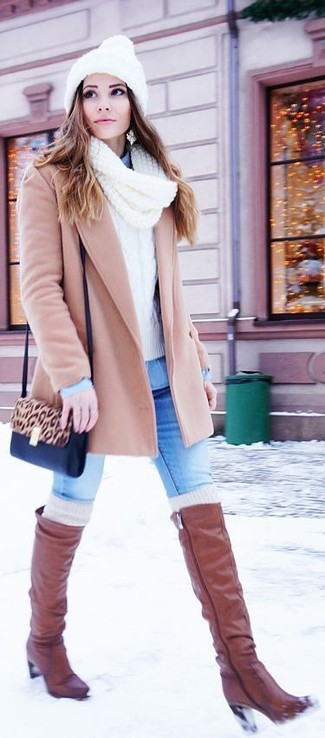 How to wear: blue skinny jeans, light blue denim shirt, white cable sweater, beige coat