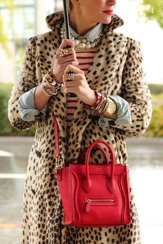How to wear: red leather satchel bag, light blue denim shirt, white and red horizontal striped crew-neck sweater, tan leopard fur coat