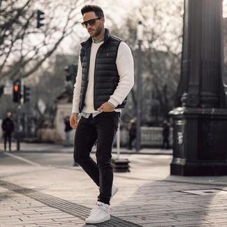 How to wear: black skinny jeans, light blue denim shirt, white crew-neck sweater, black gilet