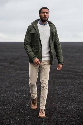 How to wear: beige chinos, blue denim shirt, white crew-neck sweater, olive military jacket
