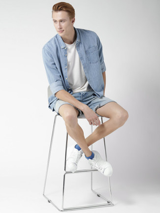 How to wear: light blue denim shirt, white crew-neck t-shirt, light blue denim shorts, white leather low top sneakers