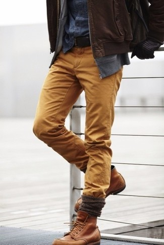 How to wear: khaki chinos, navy denim shirt, grey hoodie, brown leather bomber jacket