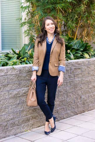 How to wear: navy dress pants, blue denim shirt, navy v-neck sweater, tan blazer