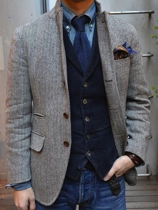 How to wear: blue jeans, blue denim shirt, navy corduroy waistcoat, grey herringbone wool blazer