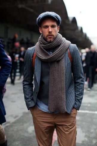 How to wear: tobacco chinos, blue denim shirt, charcoal waistcoat, grey vertical striped blazer