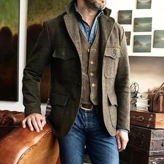 How to wear: blue skinny jeans, blue denim shirt, dark brown corduroy waistcoat, brown wool field jacket