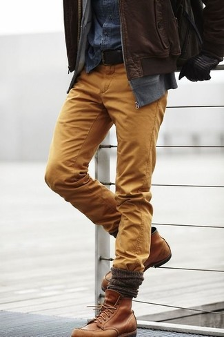How to wear: mustard chinos, navy denim shirt, grey zip sweater, dark brown leather bomber jacket
