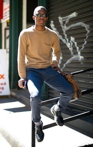 How to Wear Black Leather Derby Shoes: If you're a fan of classic pairings, then you'll love this combination of a tan crew-neck sweater and navy chinos. Complement your outfit with a pair of black leather derby shoes to effortlesslly up the style factor of any getup.