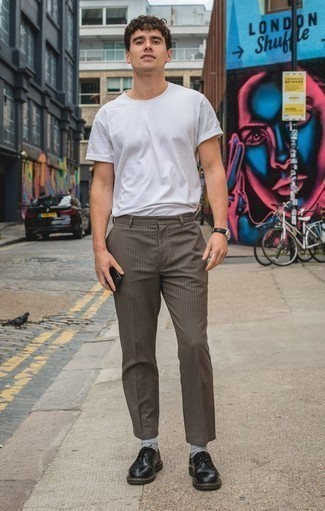 How to Wear Black Leather Derby Shoes: This relaxed casual pairing of a white crew-neck t-shirt and brown check chinos is capable of taking on different forms depending on how you style it out. Kick up the formality of your ensemble a bit by rounding off with a pair of black leather derby shoes.