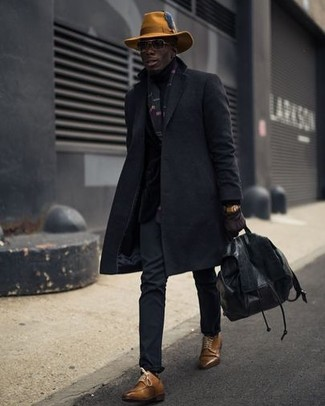 How to wear: black leather backpack, brown leather derby shoes, black chinos, black overcoat
