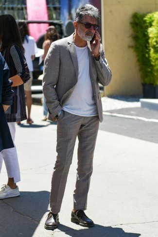 Men's Looks & Outfits: What To Wear In 2020: For a look that's casually smart and gasp-worthy, consider wearing a grey suit and a white crew-neck t-shirt. Got bored with this getup? Enter a pair of dark brown leather derby shoes to jazz things up.
