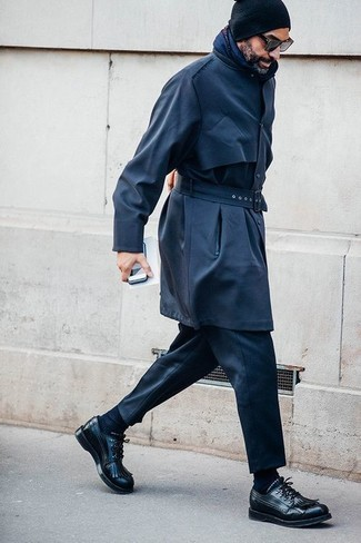 How to wear: black beanie, black leather derby shoes, black dress pants, navy trenchcoat