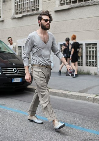 How to Wear a Grey V-neck Sweater For Men: Teaming a grey v-neck sweater and grey dress pants is a guaranteed way to breathe personality into your styling routine. A pair of light blue leather derby shoes is a nice idea to complement your ensemble.