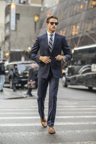 How to wear: grey vertical striped tie, brown leather derby shoes, white dress shirt, charcoal suit