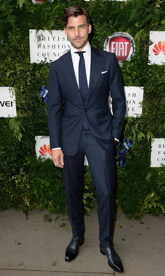How to wear: navy tie, dark green leather derby shoes, white dress shirt, black suit