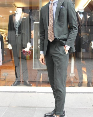 How to wear: tan houndstooth tie, black leather derby shoes, light blue dress shirt, dark green suit