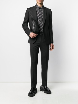 How to wear: black leather fanny pack, black chunky leather derby shoes, black and white print dress shirt, black suit