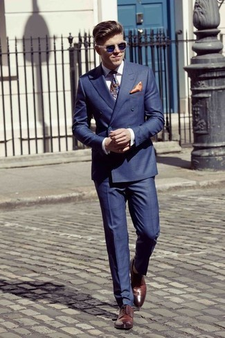 How to Wear a Blue Paisley Tie For Men: Serve people a head-spinning look in a navy suit and a blue paisley tie. Add a more informal twist to an otherwise standard outfit by slipping into burgundy leather derby shoes.
