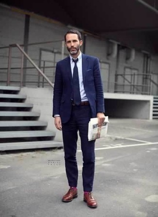 How to Wear Hot Pink Socks For Men: Wear a navy suit with hot pink socks for both on-trend and easy-to-style getup. Put a more elegant spin on an otherwise utilitarian outfit by finishing off with tobacco leather derby shoes.