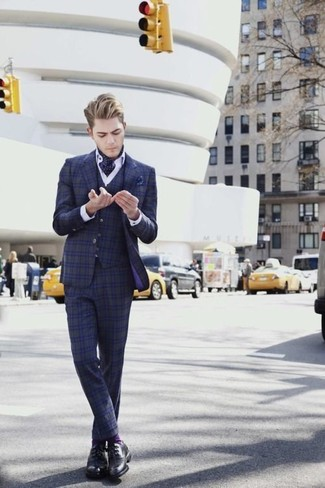 How to wear: navy polka dot pocket square, black leather derby shoes, white dress shirt, navy plaid three piece suit