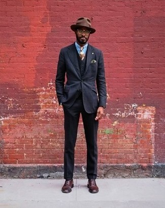 How to wear: brown wool hat, burgundy leather derby shoes, light blue dress shirt, black three piece suit