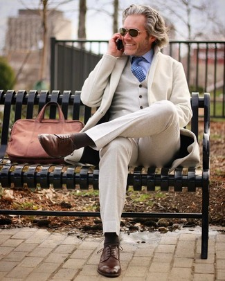 How to wear: brown leather briefcase, brown leather derby shoes, light blue dress shirt, beige wool three piece suit