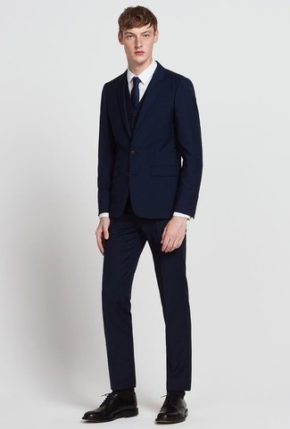 How to Wear a Navy Three Piece Suit: For a look that's refined and envy-worthy, consider wearing a navy three piece suit and a white dress shirt. Go ahead and opt for black leather derby shoes for a more relaxed feel.