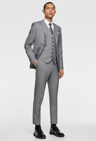 How to Wear a Grey Three Piece Suit: This pairing of a grey three piece suit and a white dress shirt is a safe option when you need to look like a real gentleman. And if you want to immediately dress down this ensemble with footwear, why not complete your look with black leather derby shoes?