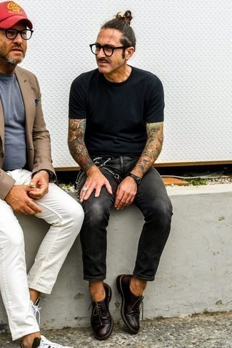 Men's Looks & Outfits: What To Wear In 2020: This outfit with a black crew-neck t-shirt and charcoal jeans isn't a hard one to score and is open to more experimentation. Bring a bit of elegance to your look by rounding off with burgundy leather derby shoes.