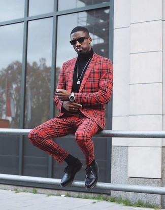 How to wear: black sunglasses, black leather derby shoes, black turtleneck, red check suit