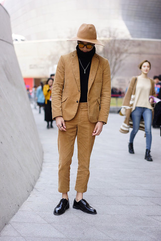 How to wear: tan wool hat, black leather derby shoes, black turtleneck, tan corduroy suit