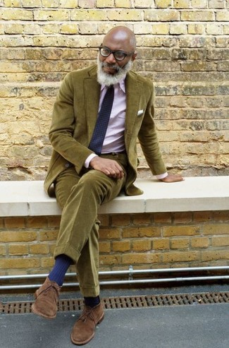 How to wear: navy geometric tie, brown suede desert boots, pink dress shirt, olive corduroy suit