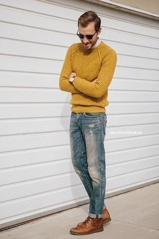 How to Wear a Mustard Crew-neck Sweater For Men: For a relaxed casual menswear style with a city style take, consider wearing a mustard crew-neck sweater and blue ripped jeans. Make your outfit a bit dressier by finishing off with a pair of brown leather desert boots.