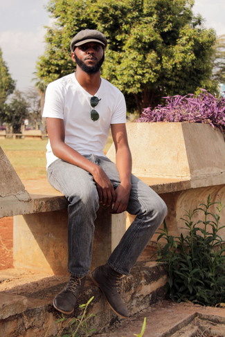 How to wear: brown flat cap, charcoal suede desert boots, grey jeans, white crew-neck t-shirt