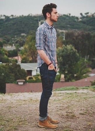 How to Wear a Navy Plaid Long Sleeve Shirt For Men: A navy plaid long sleeve shirt and navy jeans are the kind of a no-brainer off-duty look that you need when you have no extra time. For something more on the dressier end to complement this look, enter tan suede desert boots into the equation.
