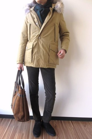 How to wear: brown suede tote bag, black suede desert boots, dark brown corduroy jeans, yellow parka